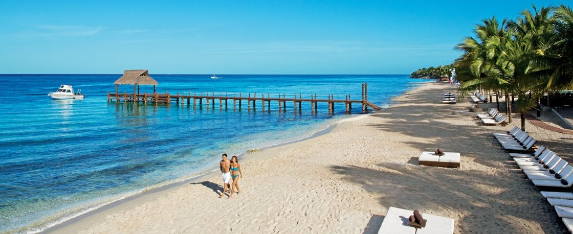 Ceremony on the beach of Secrets Aura Resort